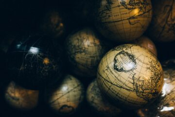 Birds eye view of antique globes stacked on top of each other